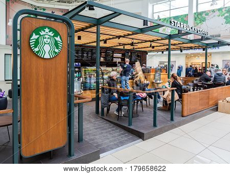 SAMARA RUSSIA - APRIL 1 2017: Starbucks cafe interior in Samara shopping center Kosmoport. Starbucks Corporation is an American global coffee company and coffeehouse chain