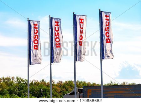 SAMARA RUSSIA - MAY 29 2016: Flags with emblem Bosch against the blue sky. Robert Bosch LLC is a multinational engineering and electronics company