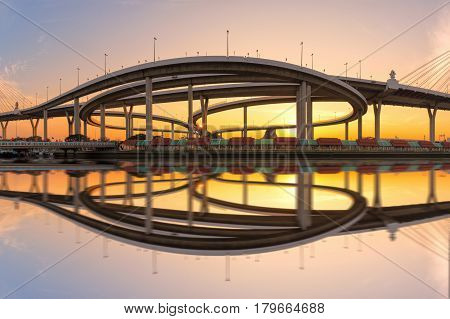 Motorway Expressway Freeway the infrastructure for transportation in modern city urban view against the sunset sky