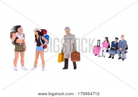 Close Up Of Miniature Businessman And Tourist People Isolate On White Background. Elegant Design Wit