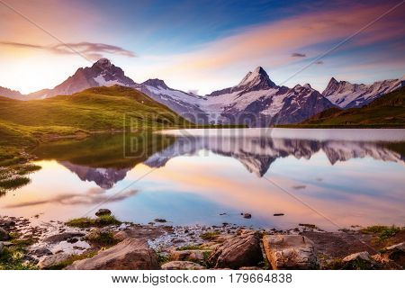 Captivating scene of the snow rocky massif. Gorgeous dawn. Location place Bachalpsee in Swiss alps, Grindelwald, Bernese Oberland, Europe. Wonderful image of wallpaper. Explore the world's beauty.
