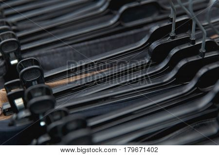 Selective Focus Clothes Hangers In The Store With Blur.