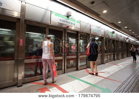 LAVENDER SINGAPORE - JANUARY 19 2017: Passengers waiting in Lavender MRT subway station Singapore.