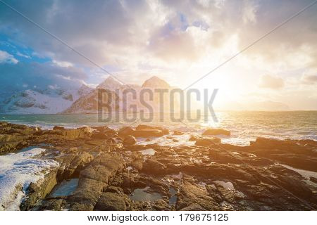Sunrise on sea stone coastline