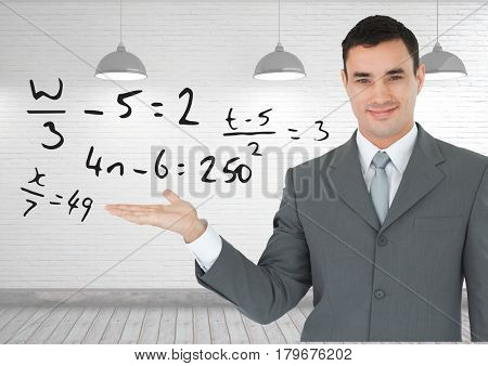 Digital composite of Man with open palm hand under math equations
