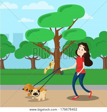 Woman walking with two dog in the park