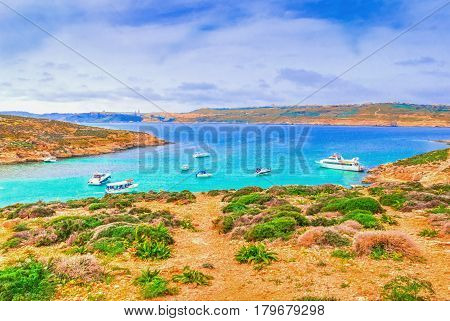 Beautiful view over the famous Blue Lagoon of Comino island in summer, amazing place of Malta