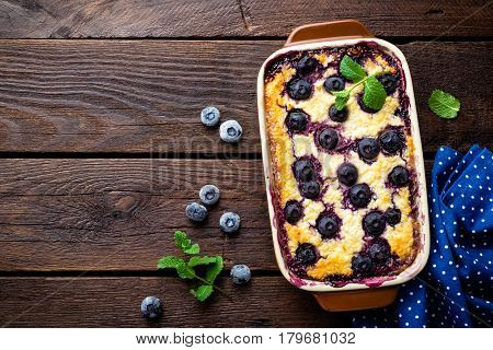 Blueberry cheesecake on dark wooden rustic backgroud top view