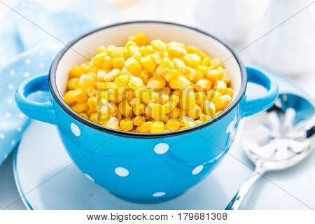 Corn canned on white background close up