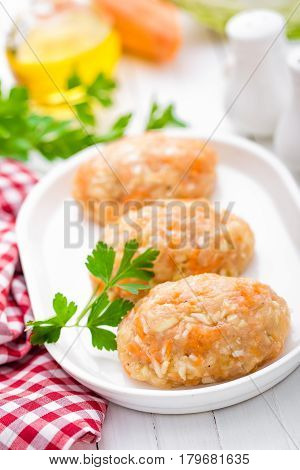 Raw uncooked meat cutlets with vegetables baby food