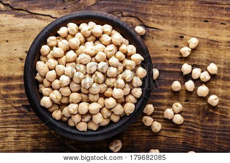 Chickpea on dark wooden rustic background close up