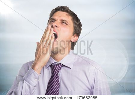Digital composite of Close up of man in lavender shirt yawning with flare against blurry grey wood panel