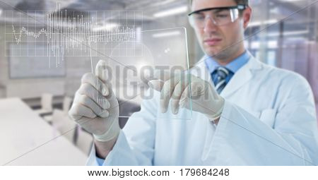 Digital composite of Man in lab coat with glass device and white graph with flare against blurry lab
