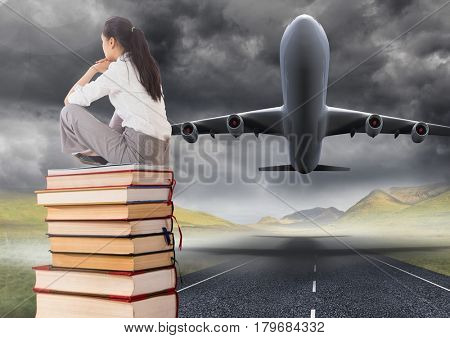 Digital composite of Business woman sitting on Books stacked by plane take off runway
