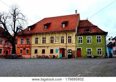 Typical medieval houses. Urban landscape in the downtown of the medieval city Sighisoara, Transylvania