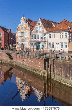 STADE, GERMANY - MARCH 27, 2017: Former mayor house with reflection in the water in Stade, Germany