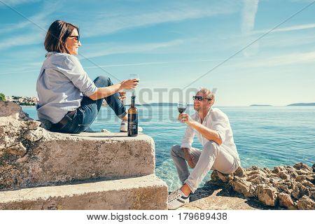 Couple in love have romantic date in blue sea lagune