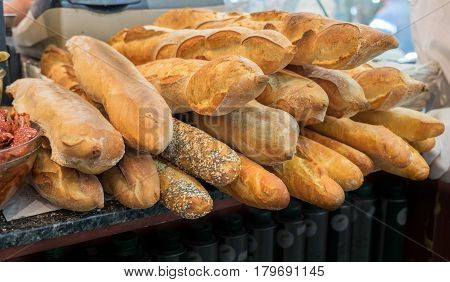 Baguette - long, thin loaf of French bread, for sale at Mahane Yehuda Market, popular marketplace in Jerusalem, Israel