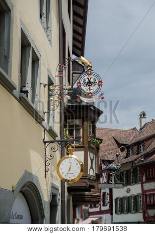 STEIN AM RHEIN SWITZERLAND - JUNE 11 2013: Clock on the house wall at medieval town Stein Am Rhein. Schaffhausen canton. Switzerland