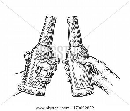 Female and male hands holding and clinking open beer bottles. Vintage vector balck engraving illustration for web, poster, invitation to party. Isolated on white background.