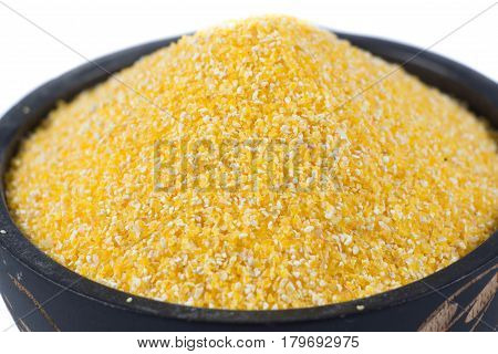 bulgur wheat groats in wooden bowl. unpolished barley. diet and health