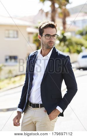 Man wearing jacket and glasses in street