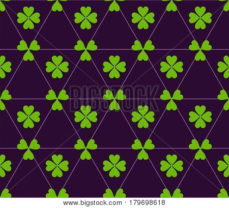 Seamless colored pattern. Print of green color clovers four and three leaves and lines of triangles on dark purple background.