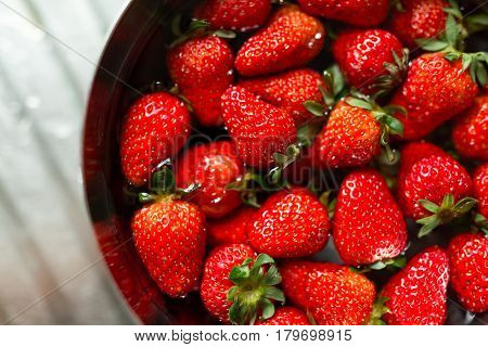 Strawberry soaking water in bowl