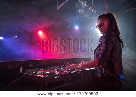 Young dj with mixing control