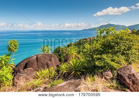 View from Anse Major Trail over the northwest coastline of Mahe island and granite rock in the foreground