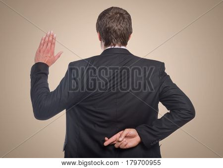 Digital composite of Back of business man with hand up and fingers crossed against cream background