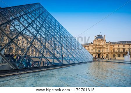 Paris- March 21, 2015: The large glass pyramid of the Louvre Museum on March 21, 2015. The Louvre Museum is one of the largest museums of the world