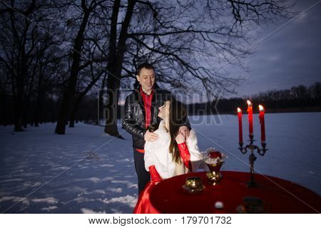 Beautiful And Stylish Young Couple In Red Clothes Posing. Romantic Love Story Of Lovers. Man And Wom