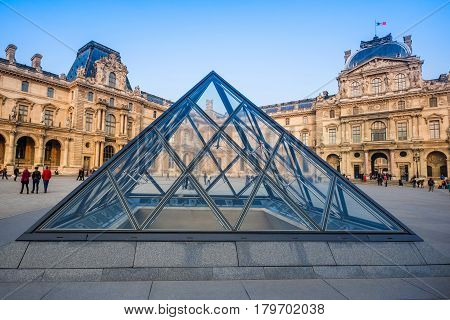 PARIS FRANCE- March 21: The large glass pyramid of the Louvre Museum on march 21 2015. The Louvre Museum is one of the largest museums of the world