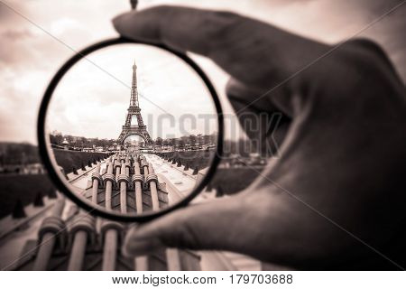PARIS - MARCH 15 : The Eiffel Tower through the tourist's lens in monotone on MARCH 15, 2015 in Paris. The Eiffel tower is the most visited monument of France.