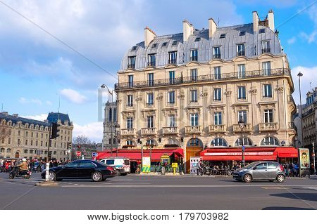 Paris, France - March 22, 2015: People going out for work, eating , drinking and spending their time during a sunny day in Paris, France