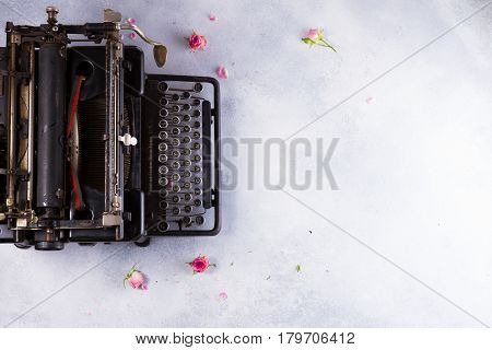 Workspace with black vintage typewriter on gray desktop
