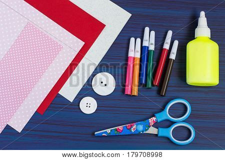 Making a greeting card for Mother's Day. Children's art project. DIY concept. Step-by-step photo instruction. Step 1. Preparation of materials and tools (paper buttons glue scissors markers)