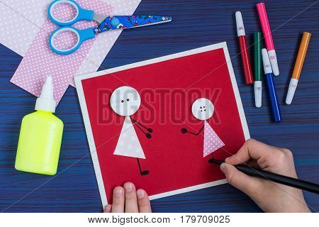 Making a greeting card for Mother's Day. Children's art project. DIY concept. Step-by-step photo instruction. Step 4. Creation images of mother and daughter