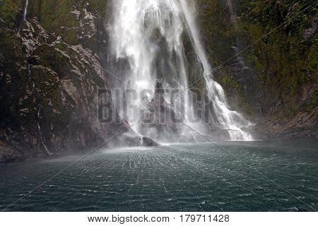 splashing of milford sound waterfall New Zealand