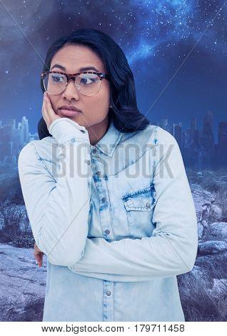 Digital composite of Worried pondering woman against starry night sky