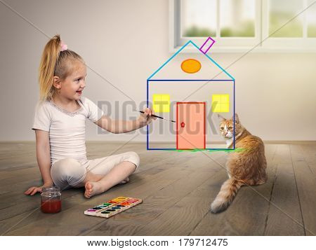 child draws a house with bright colors. The cat is watching. The concept of their housing lending and insurance of real estate