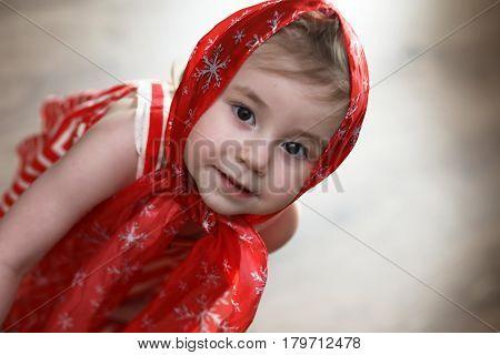 Little girl in red dresses dancing with handkerchief