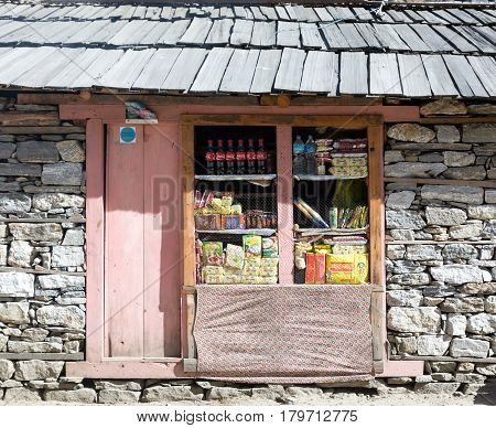 Door and Window of Small Retail Shop in the remote Village of Nepal Himalaya Mountains on popular among Tourists hiking route to Mera Peak. Nepal, Solo Khumbu area, November 8, 2016
