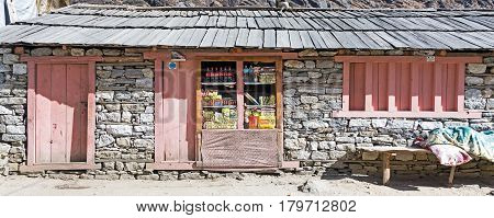 Small Retail Shop in traditional Stone bungalow in the remote Village of Nepal Himalaya Mountains on popular among Tourists hiking route to Mera Peak. Nepal, Solo Khumbu area, November 8, 2016