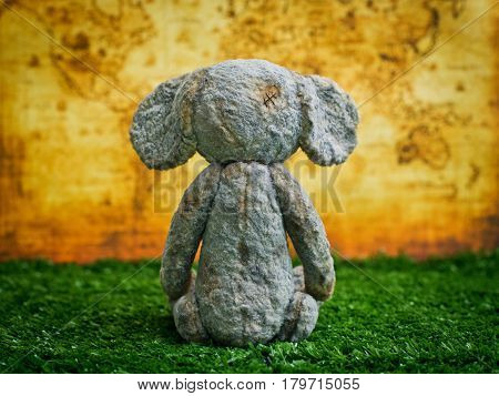Vintage Plush Elephant on the background of an old world map