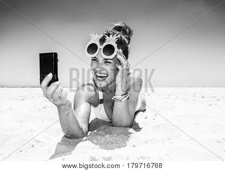 Smiling Woman In Pineapple Glasses Taking Selfie At Sandy Beach