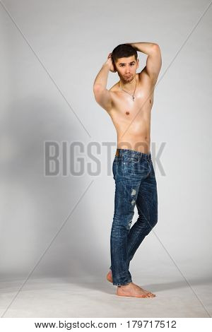 topless young brunet in jeans