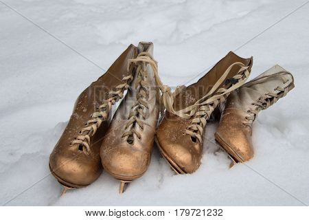 Vintage ice skates for figure skating lying on the snow.