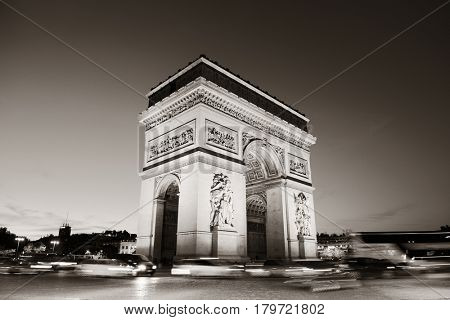 Arc de Triomphe and street view at night in Paris, France.